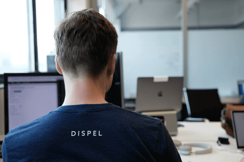Dispel employee sitting at a desk